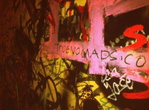 """Justin Carmack tagging his blog, True Nomads on a """"graffiti bar"""" in Cologne, Germany."""